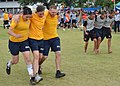 US Navy 110519-N-VA590-457 Sailors participate in the three-person, four-legged race during Sports Day at Nong Prue Municipality Sports Field.jpg