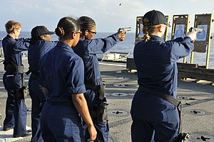 US Navy 111229-N-KS651-144 Sailors aboard the amphibious dock landing ship USS Pearl Harbor (LSD 52) participate in a 9mm pistol qualification on t.jpg