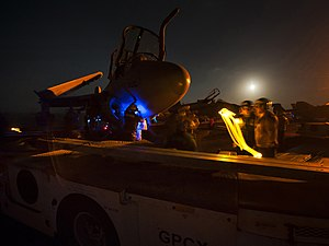 US Navy 120111-N-DR144-017 Flight deck personnel prepare to move an EA-6B Prowler on the flight deck aboard the Nimitz-class aircraft carrier USS C.jpg