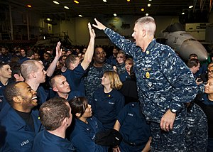 US Navy 120112-N-FI736-031 Master Chief Petty Officer of the Navy (MCPON)Rick D. West high-fives Sailors during an all-hands call aboard the aircra.jpg