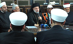 Syrian peace process - Muslims and Christians at a meeting with Arab League monitors in Damascus on 17 January 2012.