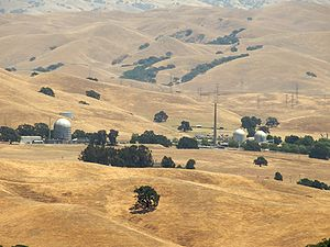 Landscape of Vallecitos Nuclear Center set in golden fields with scattered trees