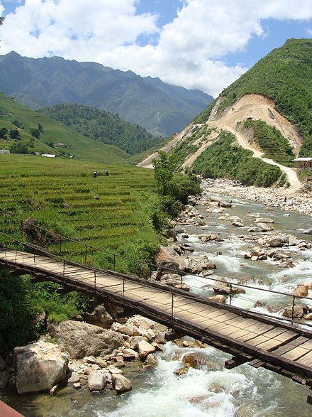 In rural areas of Vietnam, piped water systems are operated by a wide variety of institutions including a national organisation, people committees (local government), community groups, co-operatives and private companies. Village vietnam sapa bridge.jpg
