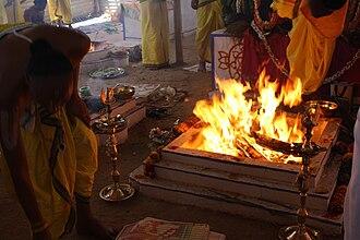 Kumbhabhishekham - Priests performing Vedic yajña at Vishnu Kunda according to Vaikhanasas' agamashastra as part of Kumbhabhishekam at Gunjanarasimhaswamy Temple, T. Narsipur