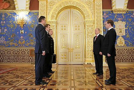 The ceremony of passing the Cheget (i.e. the nuclear briefcase) from Dmitry Medvedev's military aide to Vladimir Putin's military aide during the 2012 presidential inauguration. Vladimir Putin inauguration 7 May 2012-26.jpeg