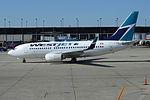 WESTJET Boeing 737-700 (C-FWBL) (7340001882).jpg