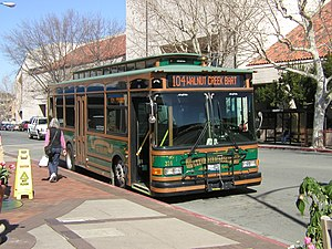 "County Connection - Old trolley bus 316 (with special ""Free Ride"" livery) in service on then-Route 104 at Broadway Plaza"