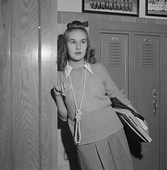Woodrow Wilson High School (Dallas) - Washington, D.C. Sweaters and long ropes of beads are popular with the girls at Woodrow Wilson High School
