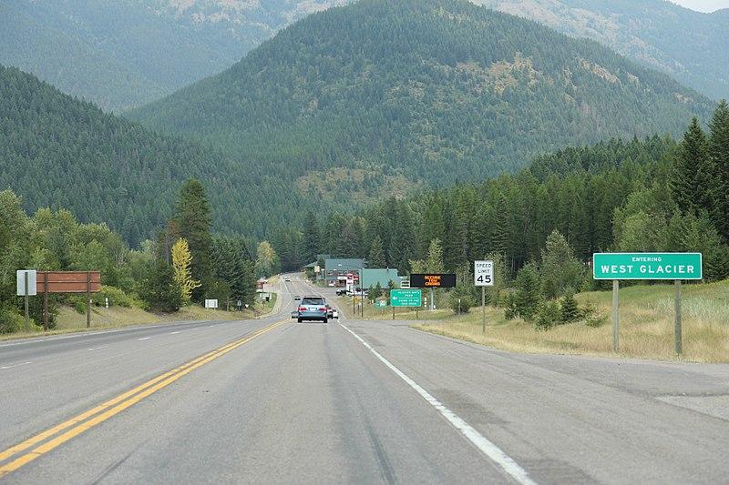 File:West Glacier Montana Sign looking east on US2.jpg
