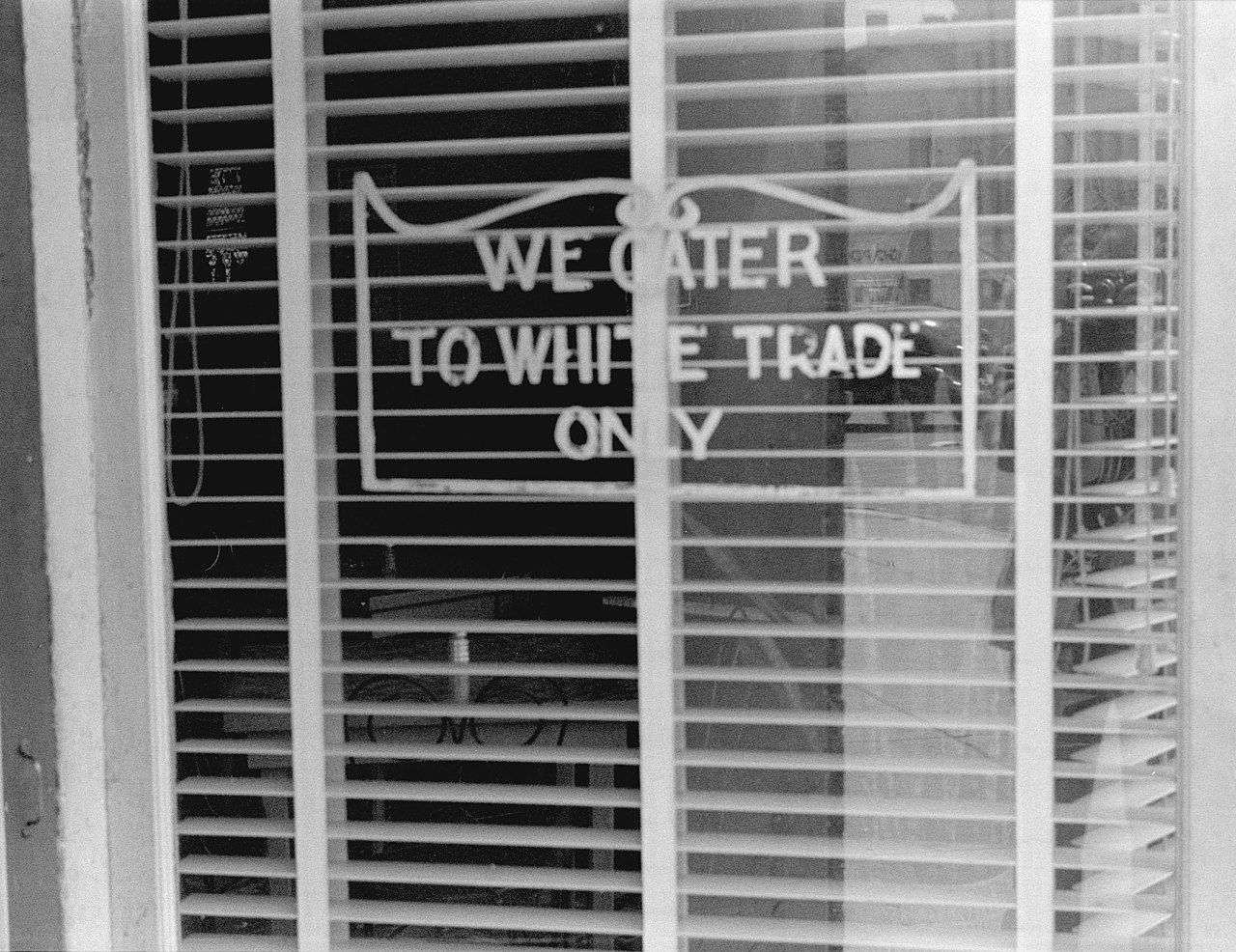 """A sign reading """"We Cater to White Trade Only."""