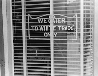"Racial segregation in the United States - ""We Cater to White Trade Only"" sign on a restaurant window in Lancaster, Ohio in 1938."
