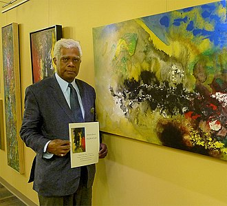 Winston Branch - Branch holding one of his paintings