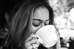 240px Woman drinking coffee
