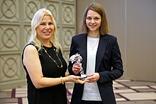 Hand-over of the Caissa Chess Award to Anna Muzychuk by Susan Polgar chairing the Commission for Women's Chess