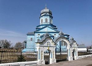 Преображенська церква і цегляна брама (1914) у Переволочній.