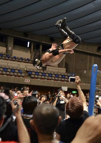 The Great Sasuke - Sasuke diving out of the ring in September 2012.