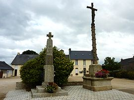 The calvary, the war memorial and the town hall in Bolazec