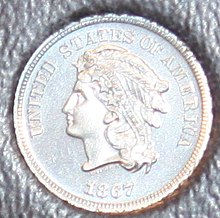 Pattern coin by James B. Longacre when the Mint was considering replacing the Shield nickel in 1867. From the collection of the Money Museum of the American Numismatic Association, Colorado Springs, CO