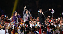 A photograph of JYJ performing at the 2014 Asian Games Opening Ceremony