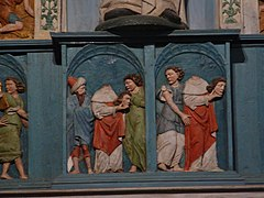 A panel in the saint Miliau altarpiece shows saint Miliau carrying his severed head.