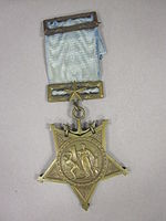 Star-shaped medal on a blue ribbon