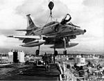 A-4F of VA-164 is craned aboard USS Hancock (CVA-19) 1975.jpg