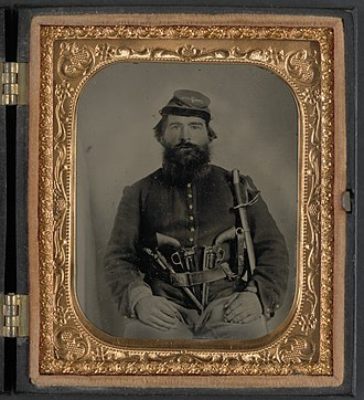 Cavalry in the American Civil War - Union cavalryman A.J. Blue armed with three pistols and a sword.