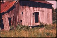 ABANDONED BARN WEATHERED BY THE ELEMENTS OFF ROUTE ^800 NEAR BARNESVILLE IN SOUTHEASTERN OHIO - NARA - 555627.jpg