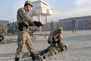 Practice (learning method) - ANCOP officer cadets practice detaining an armed insurgent at the Mazar-e Sharif Regional Training Center on December 12, 2010.