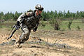 A U.S. Soldier with the Pennsylvanian Army National Guard rushes to relay information to another Soldier during a situational training exercise in Adai, Latvia, June 5, 2013, during exercise Saber 130605-O-ZZ999-003.jpg