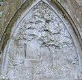 A gravestone with a grave, oak tree and meadow flowers, St Maur's Glencairn Churchyard, Ayrshire, Scotland.jpg