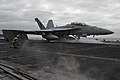 A jet launches from the flight deck of USS Carl Vinson. (6990005990).jpg