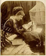 Sepia photograph of a woman reading a letter.