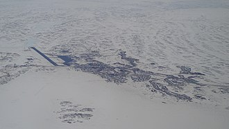 Iqaluit - Iqaluit is situated on the Everett Mountains