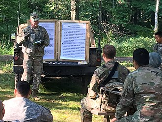 Camp Ripley - An Observer/Controller-Trainer conducts a formal After-action review for a Reserve unit