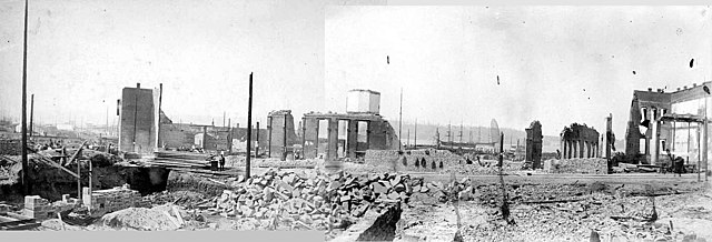 Black and white photo showing the rubble of the Great Seattle Fire
