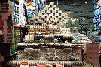 A shop in al-Madina Souq displaying Aleppo soap products, 2004 Aleppo suq - GAR - 7-06.jpg