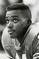 A picture of Andre Ware wearing pads.