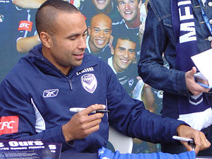 Archie Thompson - Thompson signing an autograph at a Melbourne Victory fan day.