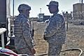 Army Maj. Duncan S. Robinson (right) with the U.S. Army Combined Arms Support Command, and Sgt. 1st Class William Lawrence, a system manager for the Brigade Modernization Integration Command, discuss the energy 121030-A-WO769-177.jpg