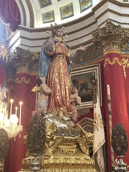 The Titular statue of the Assumption of Our Lady located in the Basilica of the Assumption of Our Lady in Mosta, Malta. The statue was crafted by Salvatore Dimech in 1868 and remodelled in 1947 by Vincent Apap. Assumption Mosta.jpg