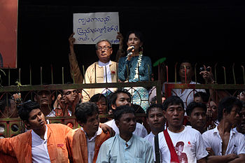 Aung San Suu Kyi speaking to supporters at National League for Democracy %28NLD%29 headquarter