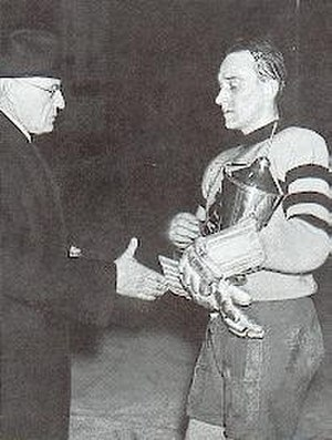 Swedish Ice Hockey Championship - AIK's Axel Nilsson receiving the Le Mat Trophy in 1938
