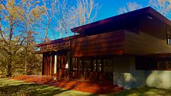Exterior view of the Bachman-Wilson House after its relocation at Crystal Bridges in Bentonville, AR.