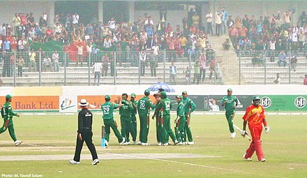 The national cricket team playing against Zimbabwe in 2009. Fans can be seen in the background waving a Bangladesh flag. Bangladesh Players Celebrate Fall of Wicket.jpg