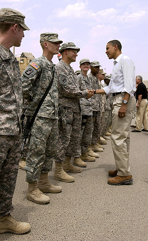 2008 in Iraq - Senator Barack Obama shakes hands with a U.S. Soldier outside Multi-National Division South East Headquarters in Basra, during his visit in Iraq, 21 July 2008.