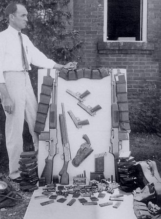 Henderson Jordan - Over a dozen guns and several thousand rounds of ammunition (including 100 20-round BAR magazines) were in the perforated Ford.