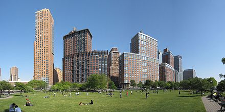 A field in Rockefeller State Park, with the buildings along River Terrace behind it Battery Park Panorama2.jpg
