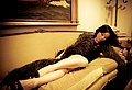 Beautiful girl reclines on a couch.jpg