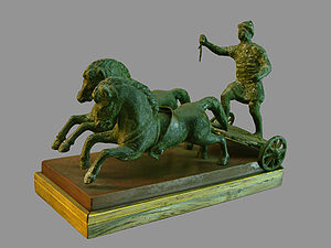 Biga (chariot) - Bronze figurine of a biga from Roman Gaul; the chariot itself is missing the breastwork
